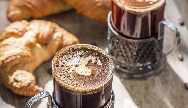 Sweet breakfast with coffee and croissant