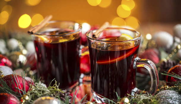 Christmas hot mulled wine with spices on a wooden table. The ide