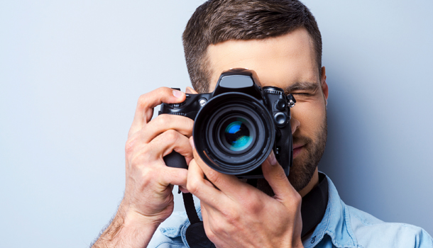 A hot guy posing with a camera