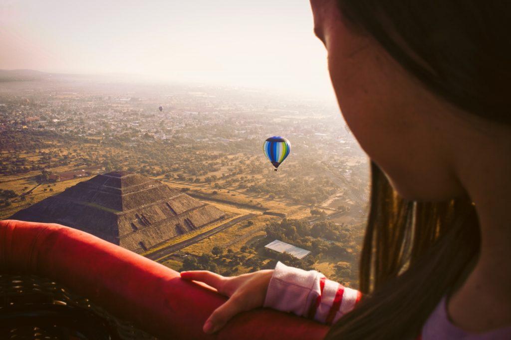hot air balloon over the pyramids in mexico