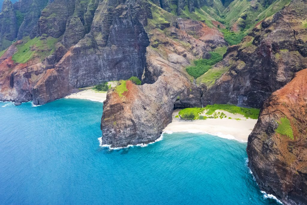 The Na Pali Coast in Hawaii is famed for its white sand beaches and clear water